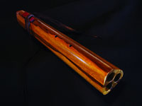Triple chambered (double drone) A minor flute, black limba with accents of bloodwood.