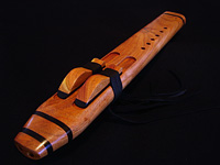 A minor drone crafted from mesquite, with accents of ebony and turquoise inlay.