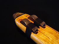 D minor drone crafted from curly Port Orford cedar, with accents of Buckeye and ebony.