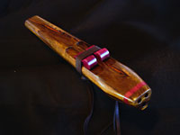 Triple chambered (double drone) G minor flute, black limba with accents of purpleheart.