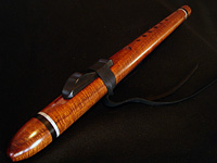 High B minor crafted from curly Hawaiian koa, with accents of ebony and Mother of Pearl inlay.