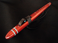 High C minor crafted from padauk, with accents of turquoise inlay and ebony.